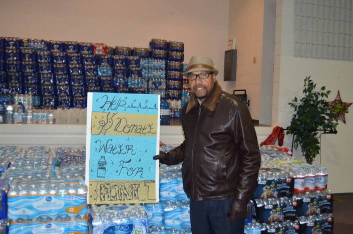 Pastor Charlie Cross with water donations